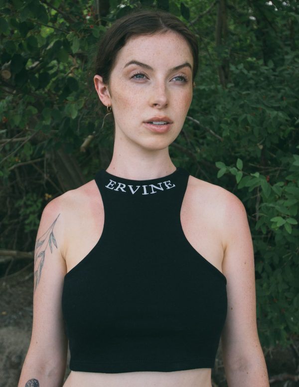 model is wearing our reverse racer crop top in the color jet black